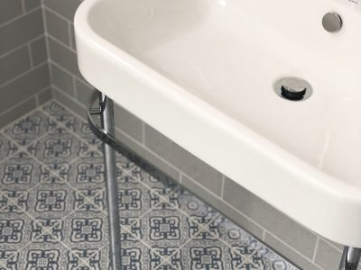 Bathroom sink and blue and grey tiles